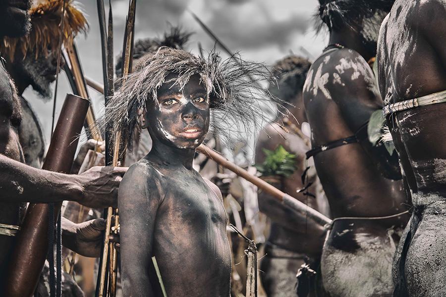 Portrait of a young Dani archer (Papua, Indonesia).