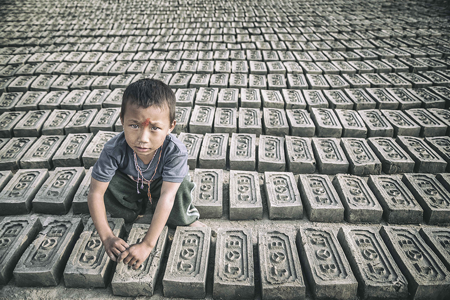 Portrait of a child in a factory of bricks (Bhaktapur, Nepal).