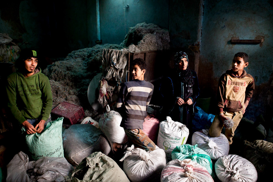 Manshiyat Naser, Egypt. A family in Manshiyat Naser - also known as Garbage City (Cairo, Egypt). People collect and recycle plastic from the 16,000 tons of daily garbage generated in Cairo (the largest African megalopolis and one of the dirtiest cities in the world).